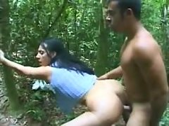 Shemale fucks and jizzes in forest