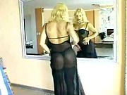 TS undresses in front of glass